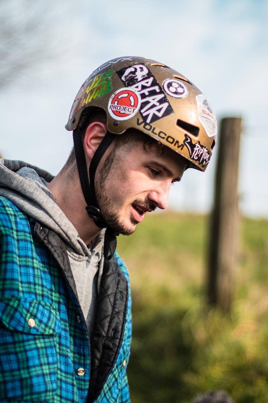 tilt-shift lens photography of person wearing helmet
