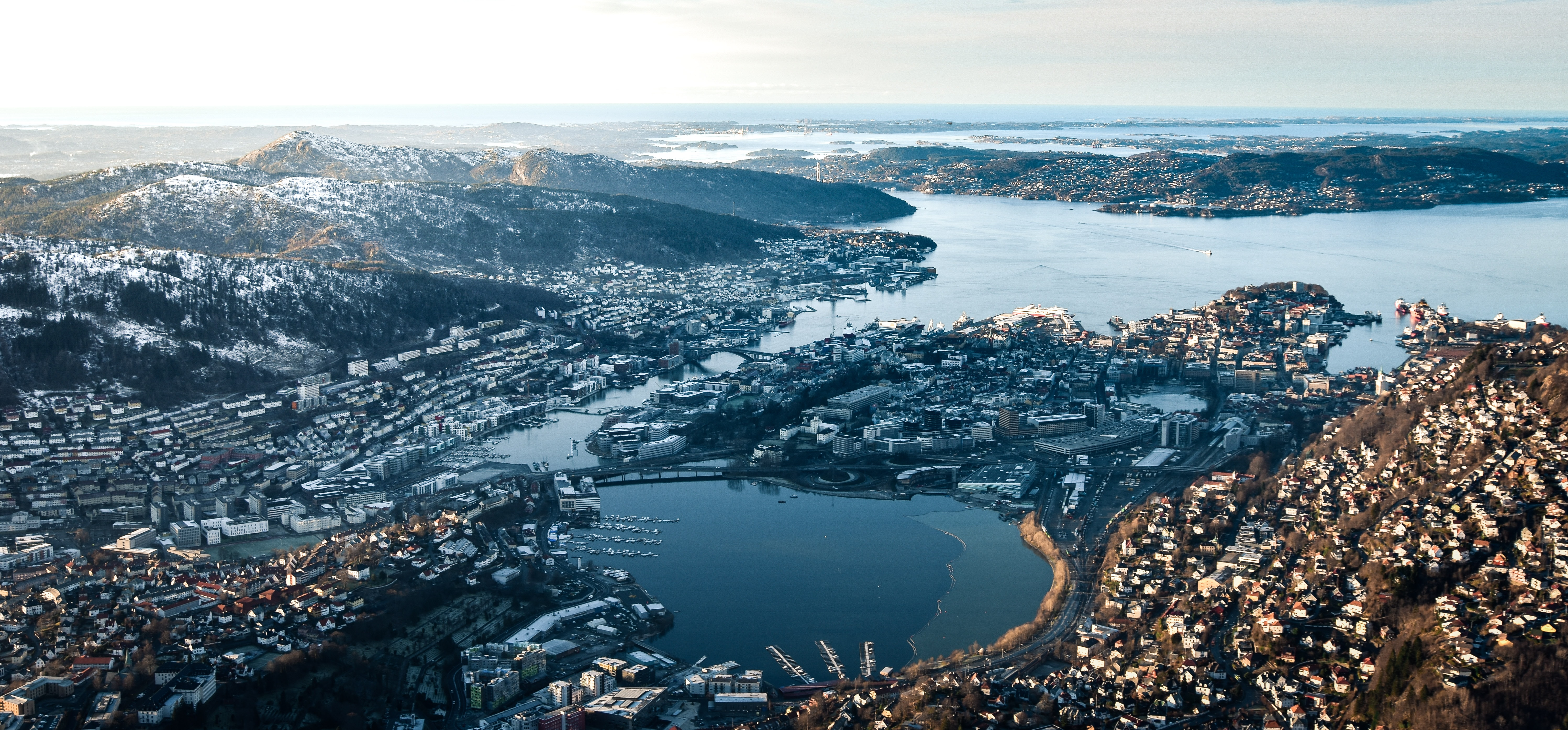 aerial photography of city and mountain