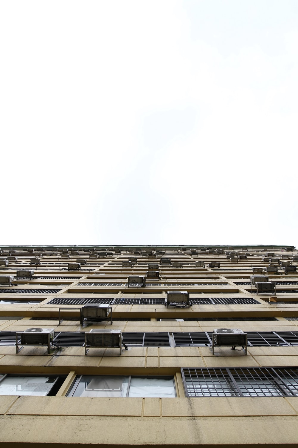beige building in worm's eye view photography
