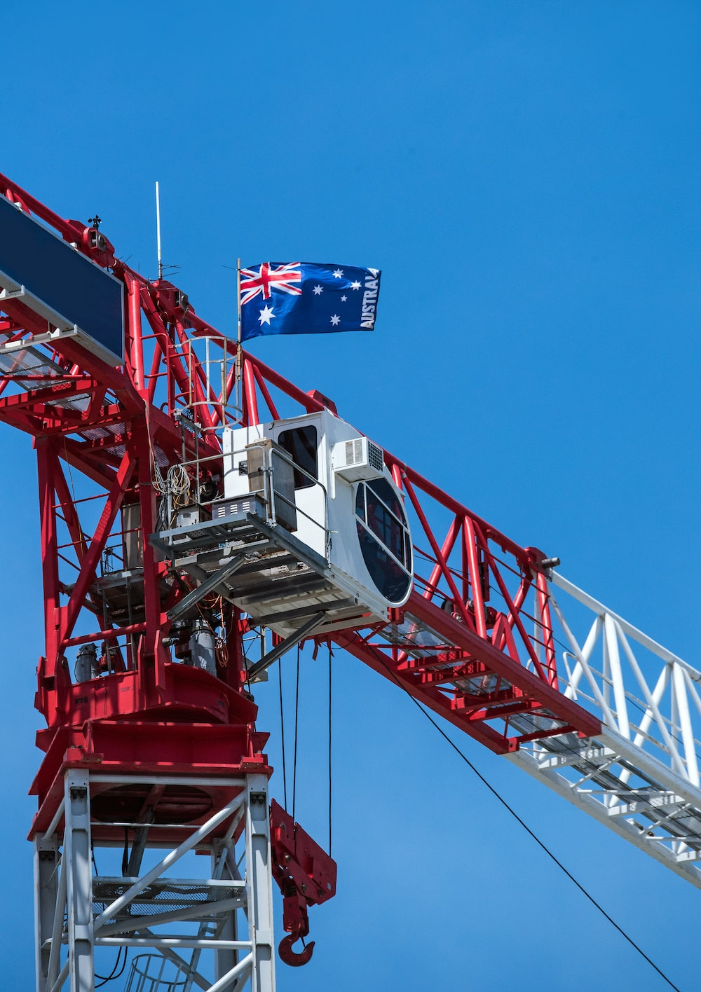 red and white metal crane