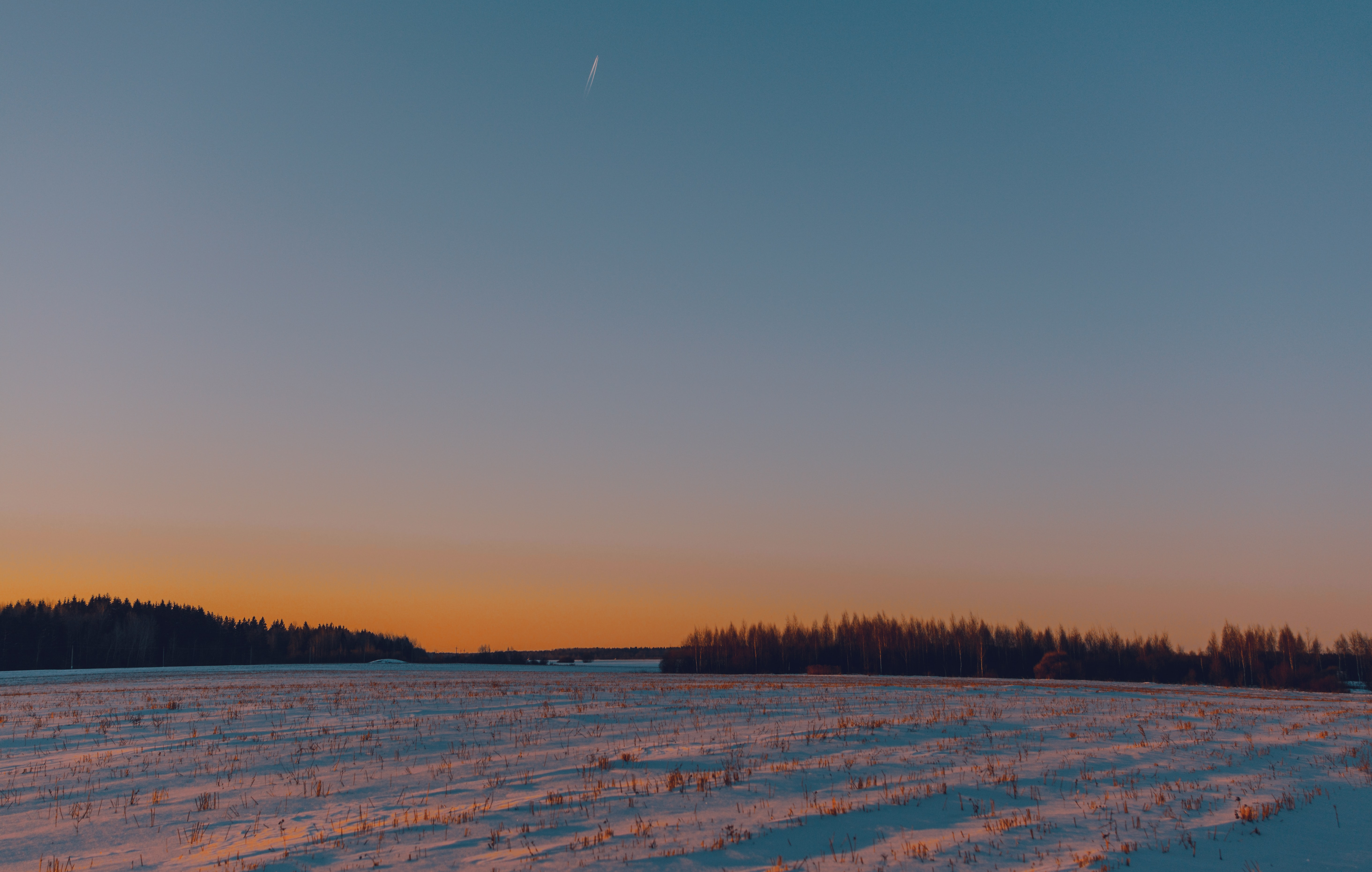 snow field during sunset