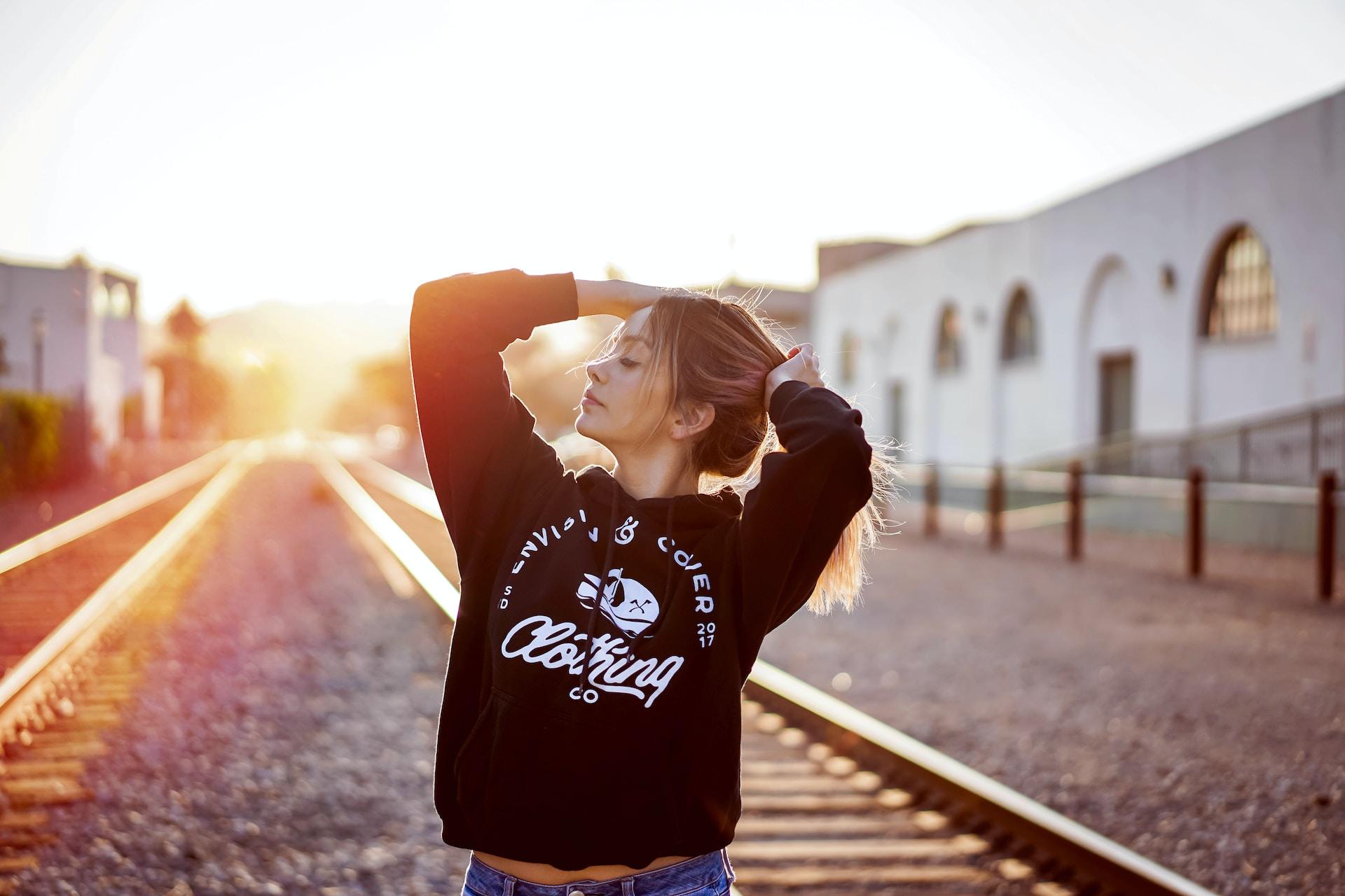 woman between railroads