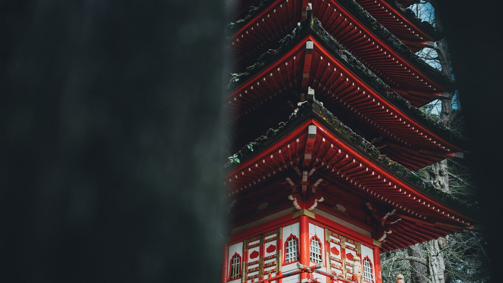red and white pagoda temple at daytime