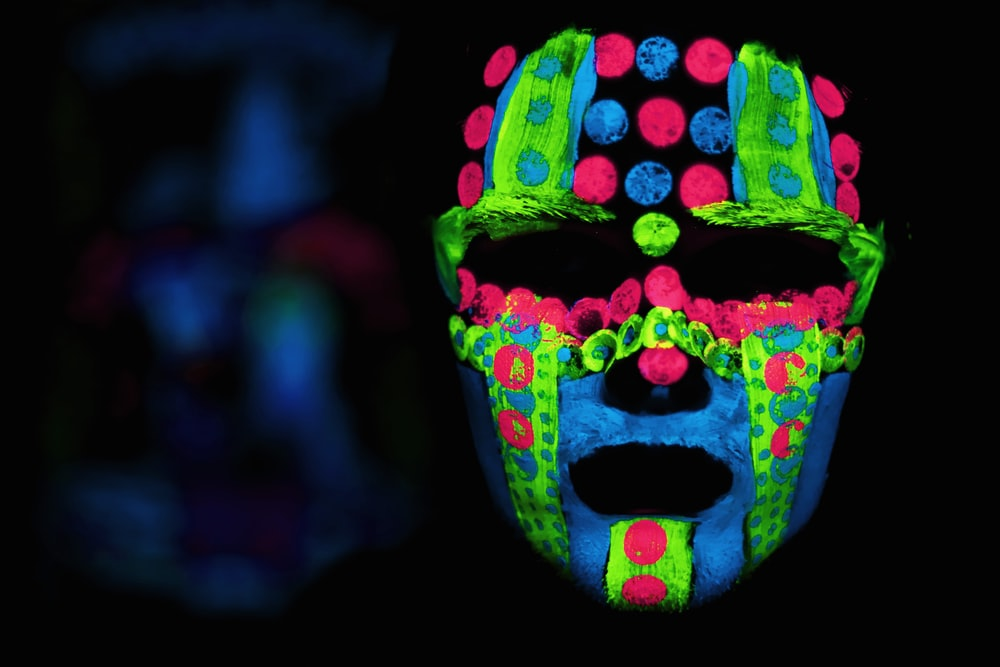 selective focus photography of neon color mask