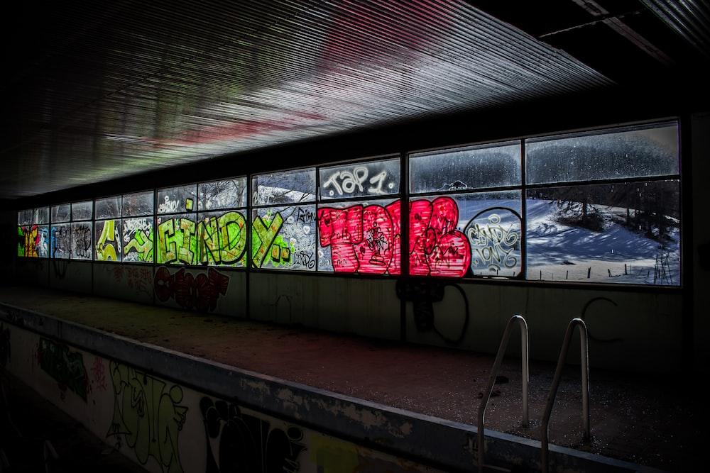 photo of windowpane with graffiti