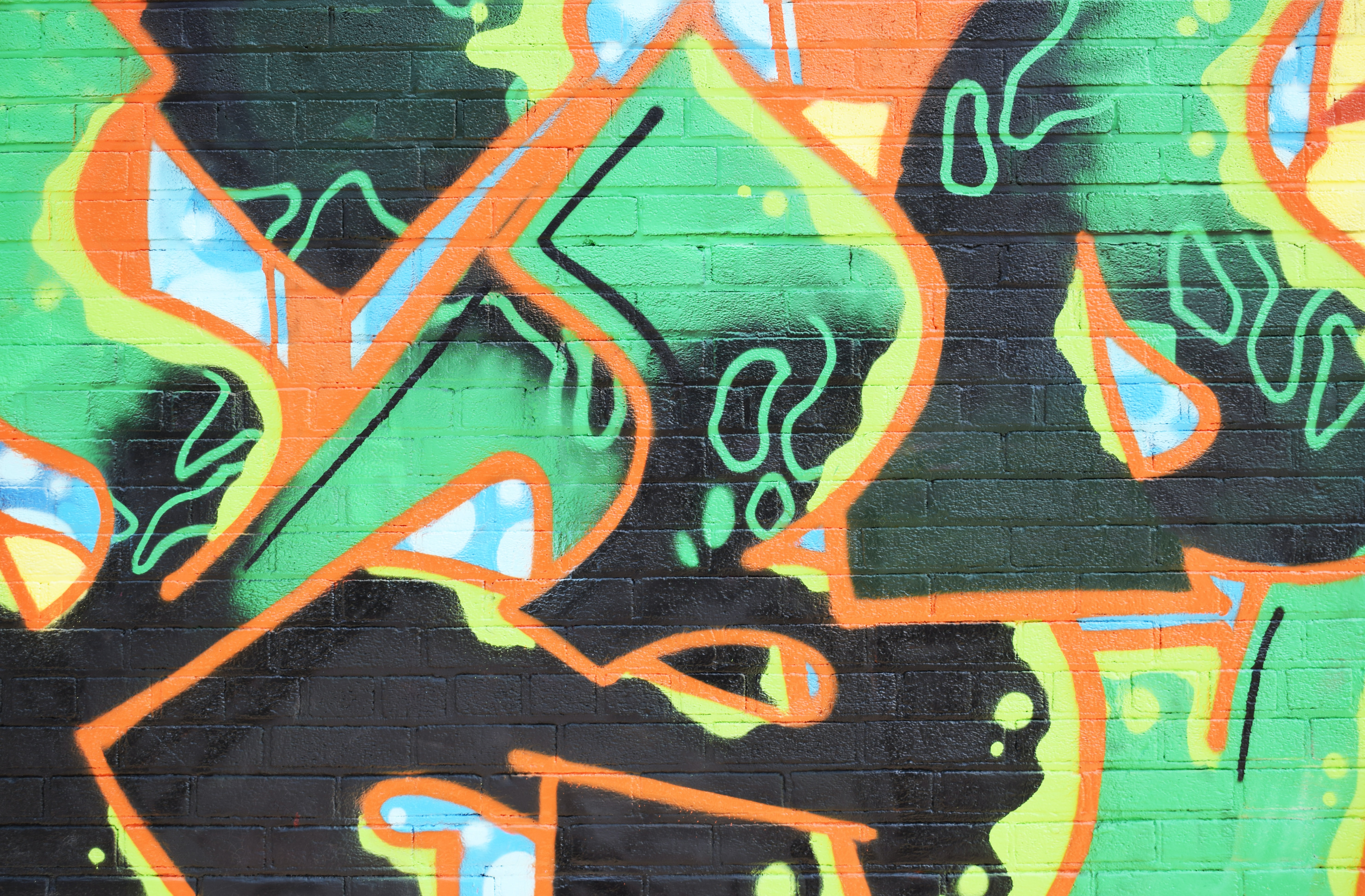 multicolored graffiti during daytime