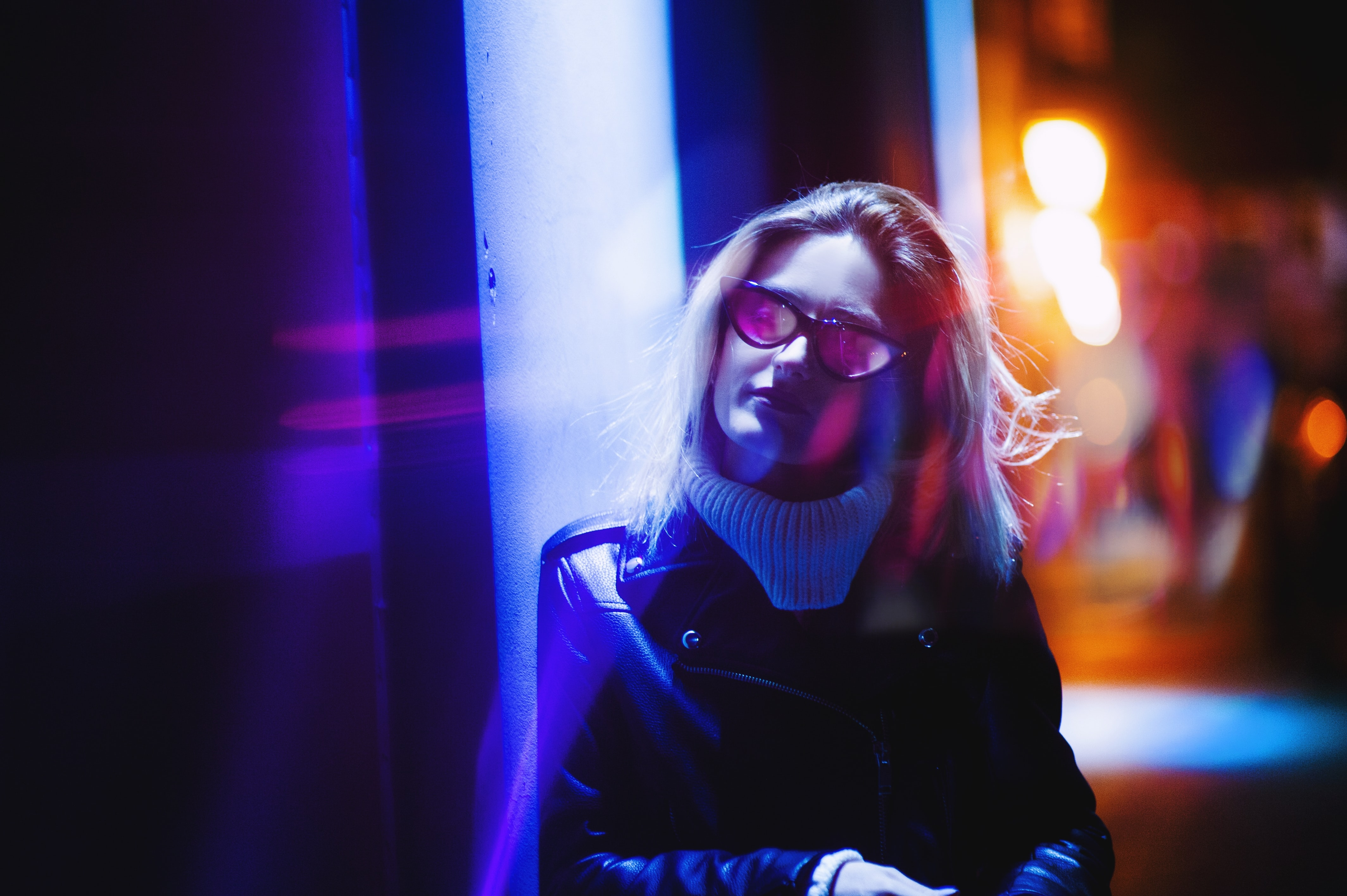 woman wearing sunglasses low light photography