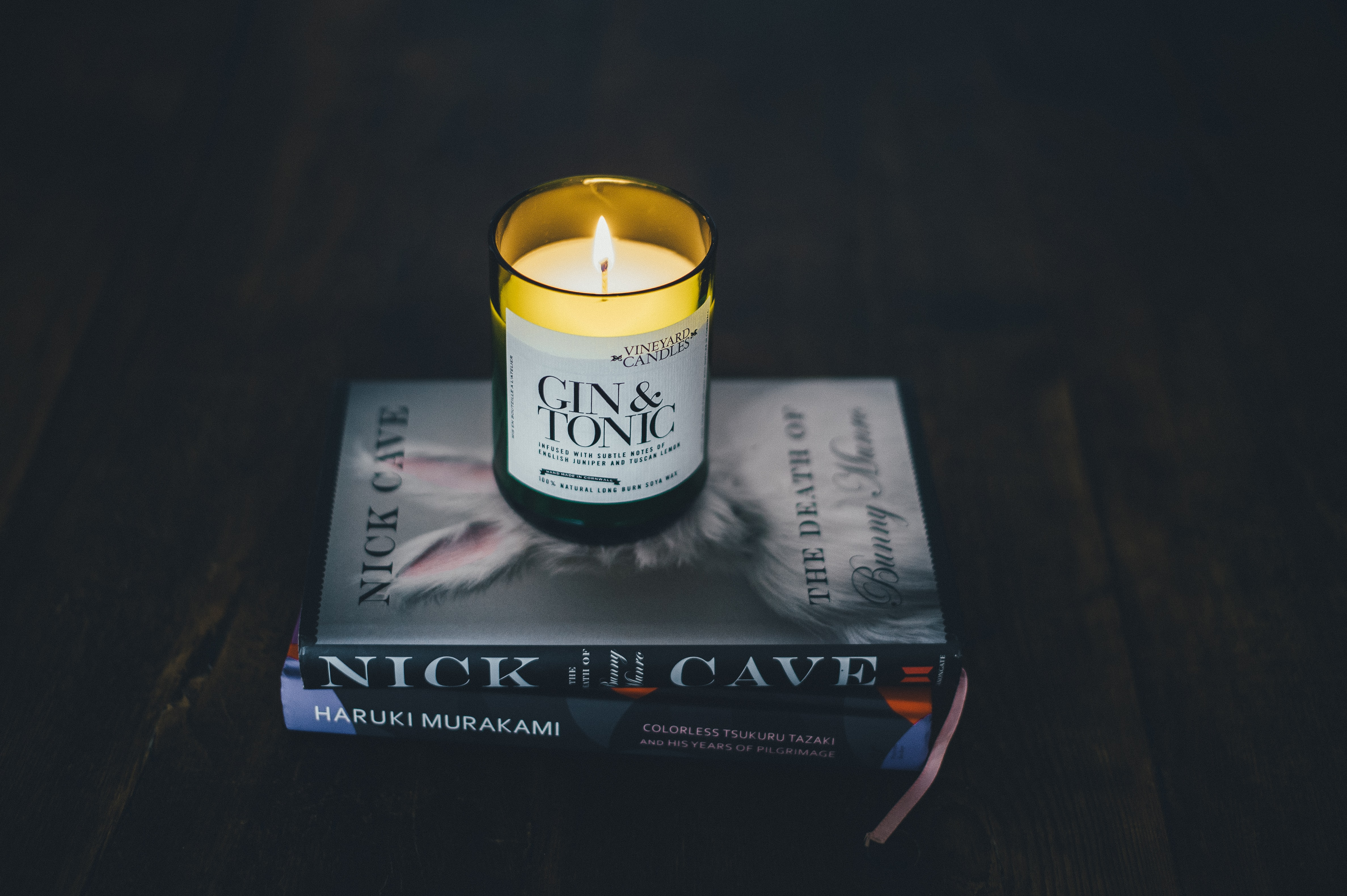 Gin & Tonic candle on Nick in the Cave book