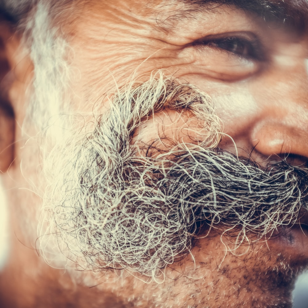 close-up photo of man with mustache
