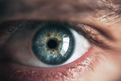 close-up photography of human eye eye zoom background