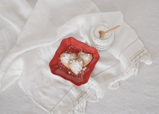 flat lay photography of heart-shaped cookies on red plate