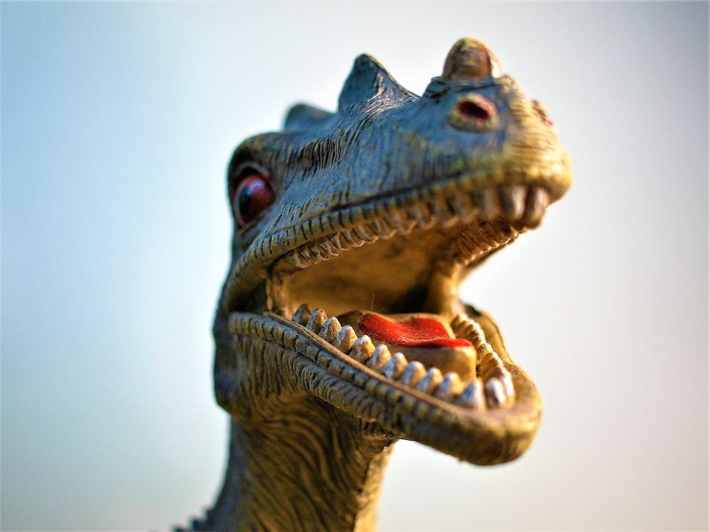 shallow focus lens photo of dinosaur toy