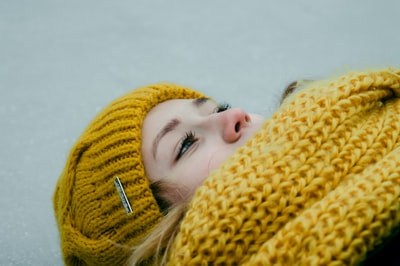 person in yellow knit hat