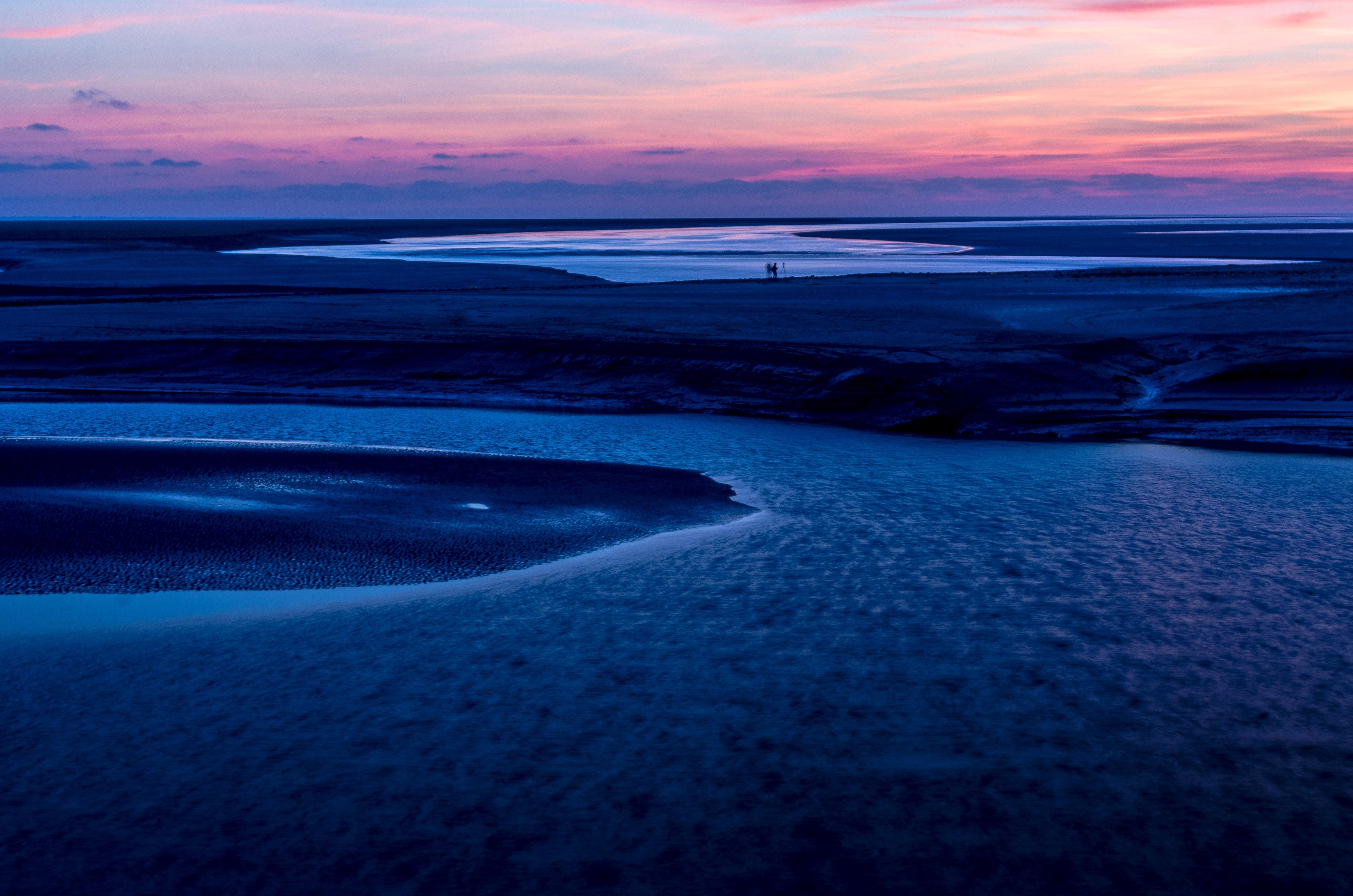 dune near on body of water