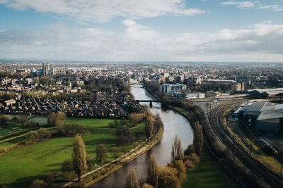 aerial photography of body of water near city at daytime york zoom background