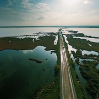 aerial photography of asphalt road in between body of water