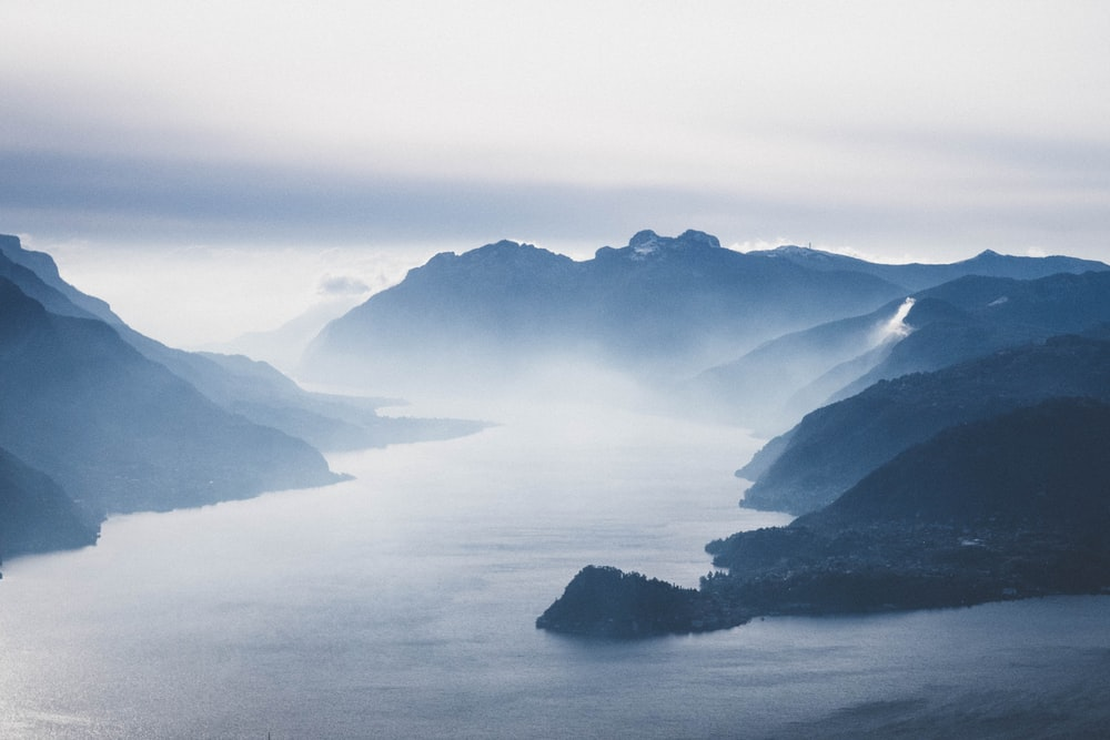bird's eye view photograph of mountains and lake