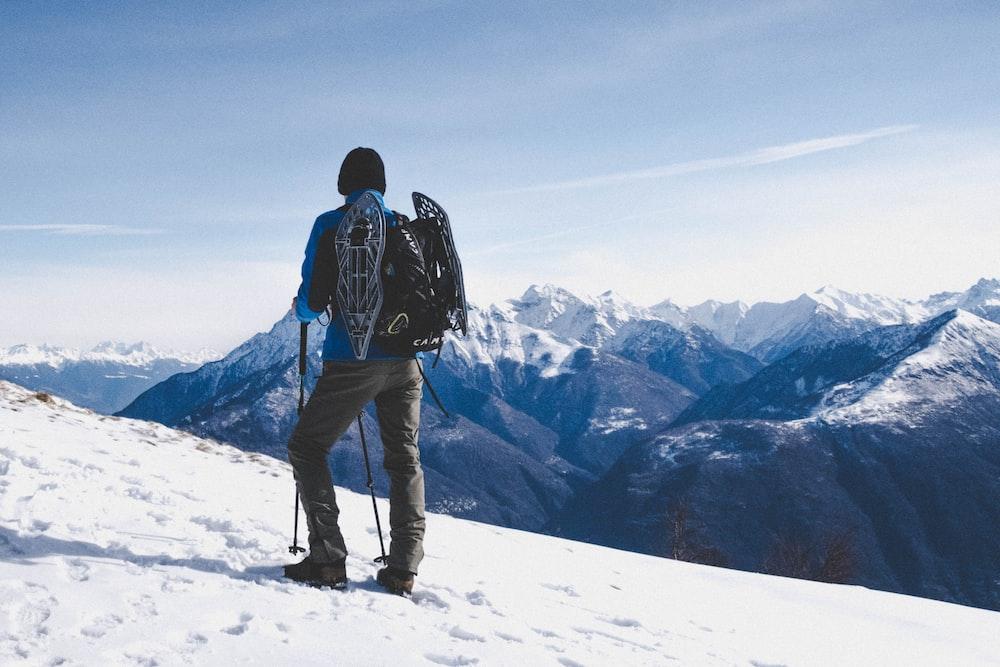 man walking on snow mountain