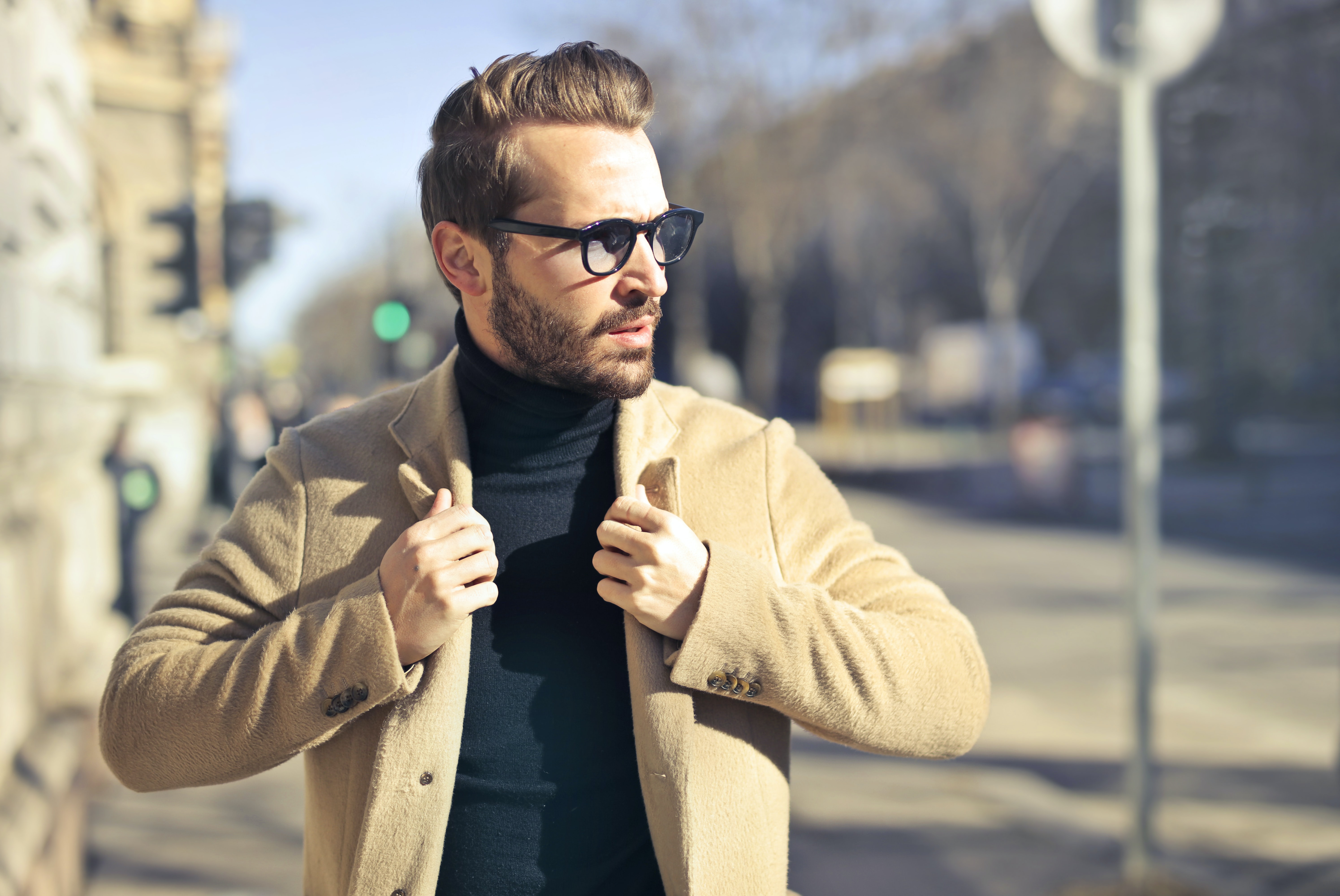 selective focus photography of man wear brown blazer and eyeglasses