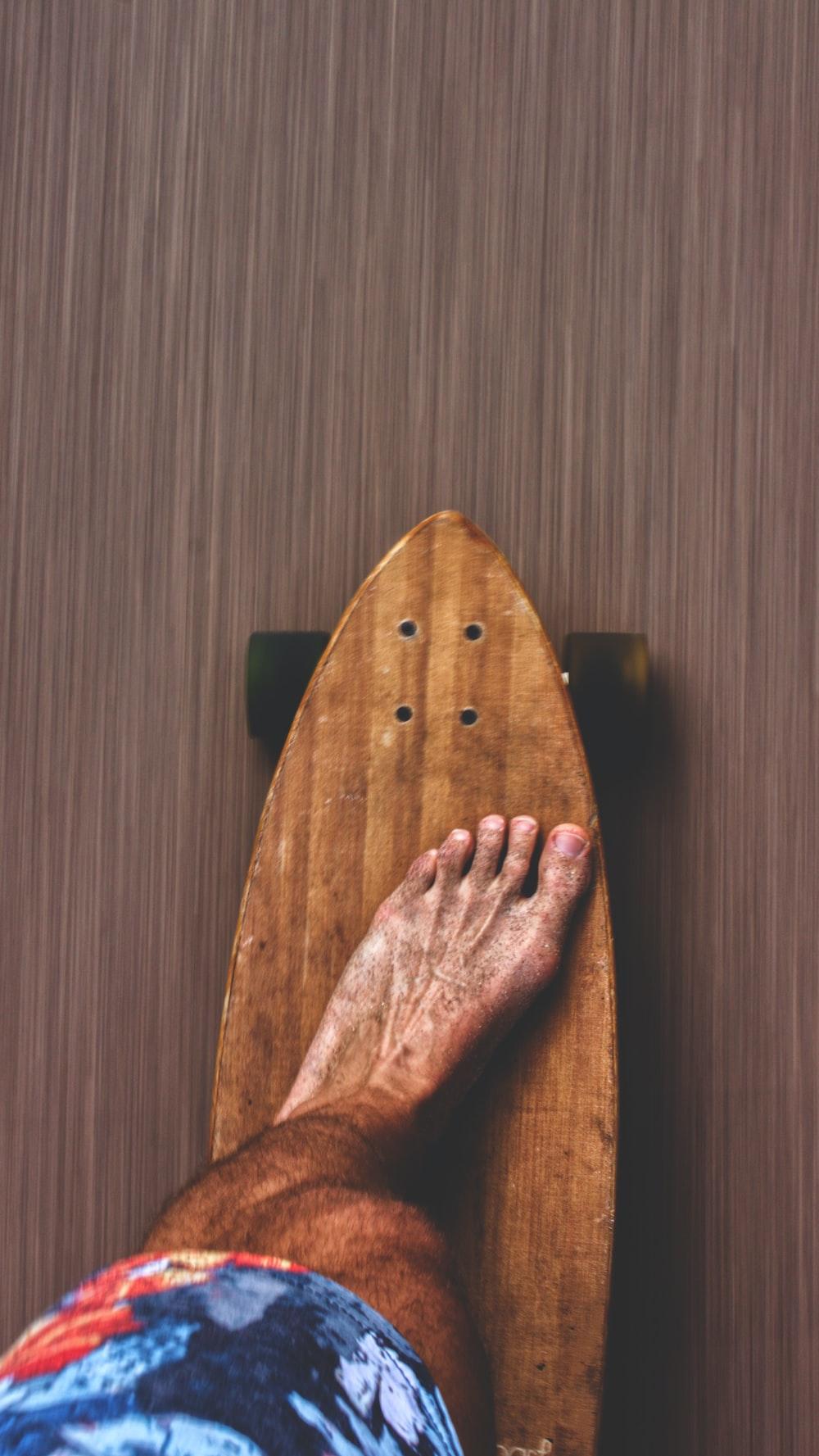 man on brown skateboard