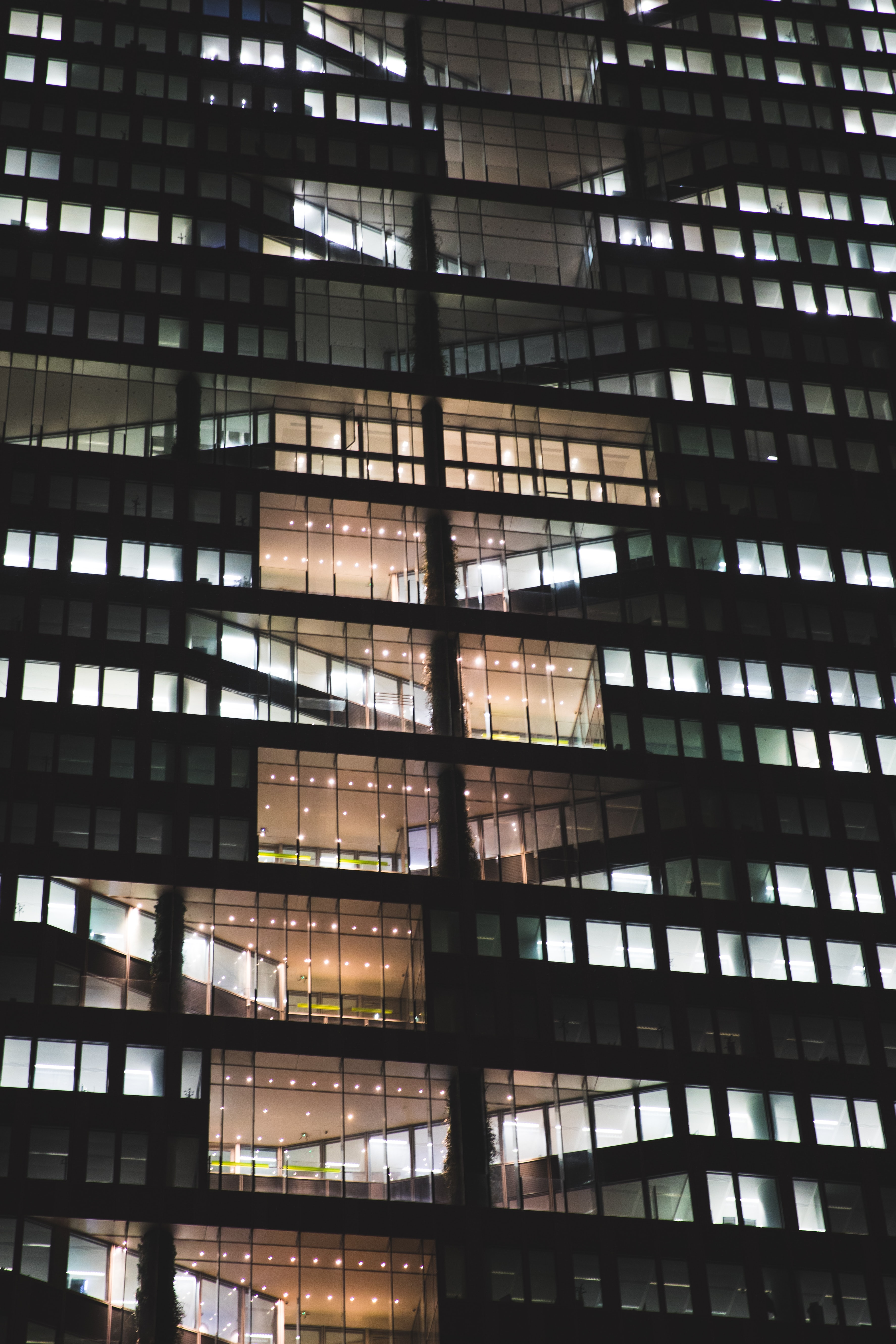 clear glass window building during night time
