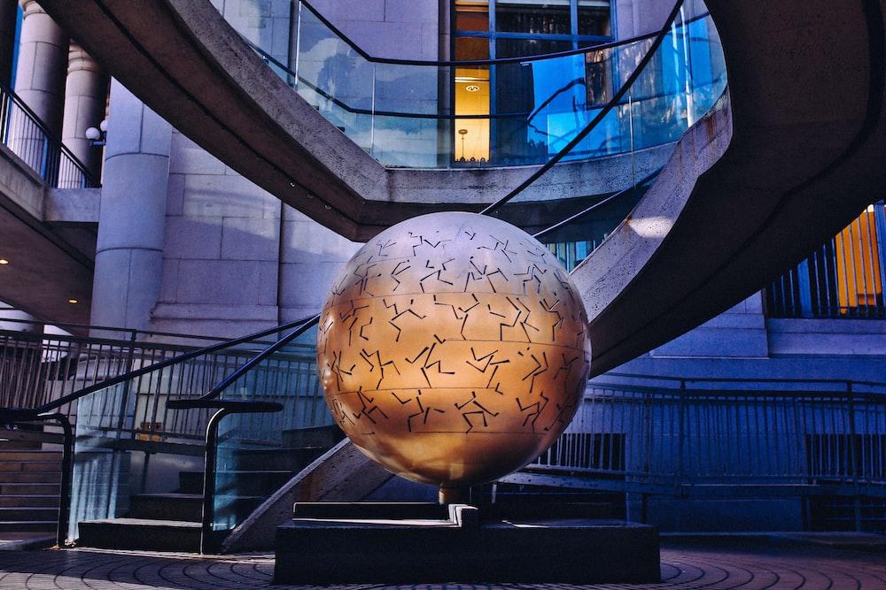globe statue inside building