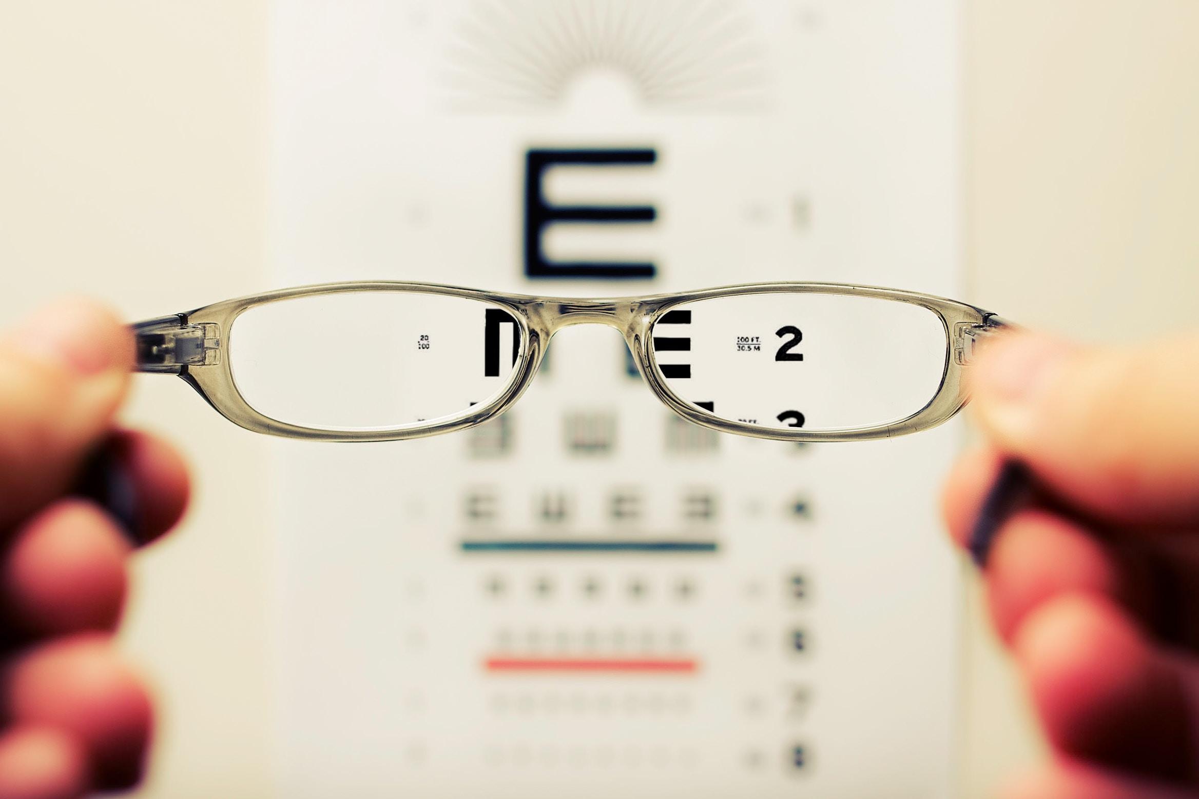 person holding eyeglasses
