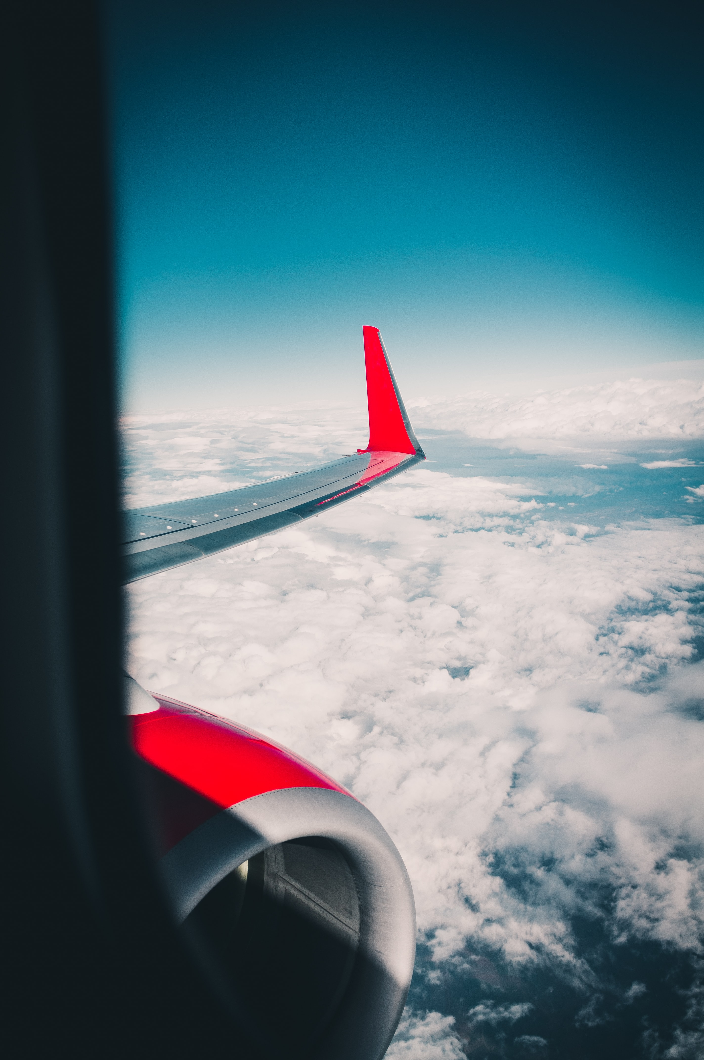 gray and red airplane