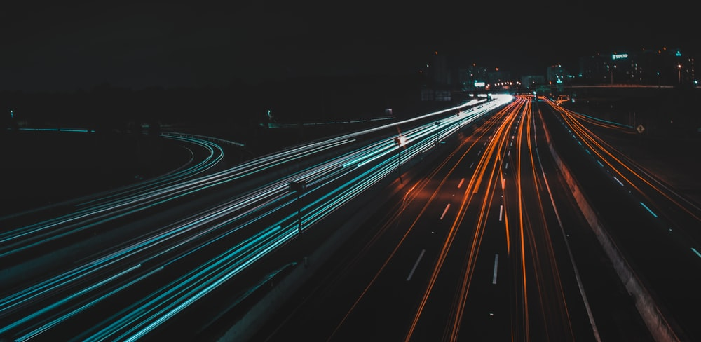 time lapse photography of lighted road at night