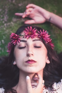 woman wearing pink floral headdress portrait selective focus photography