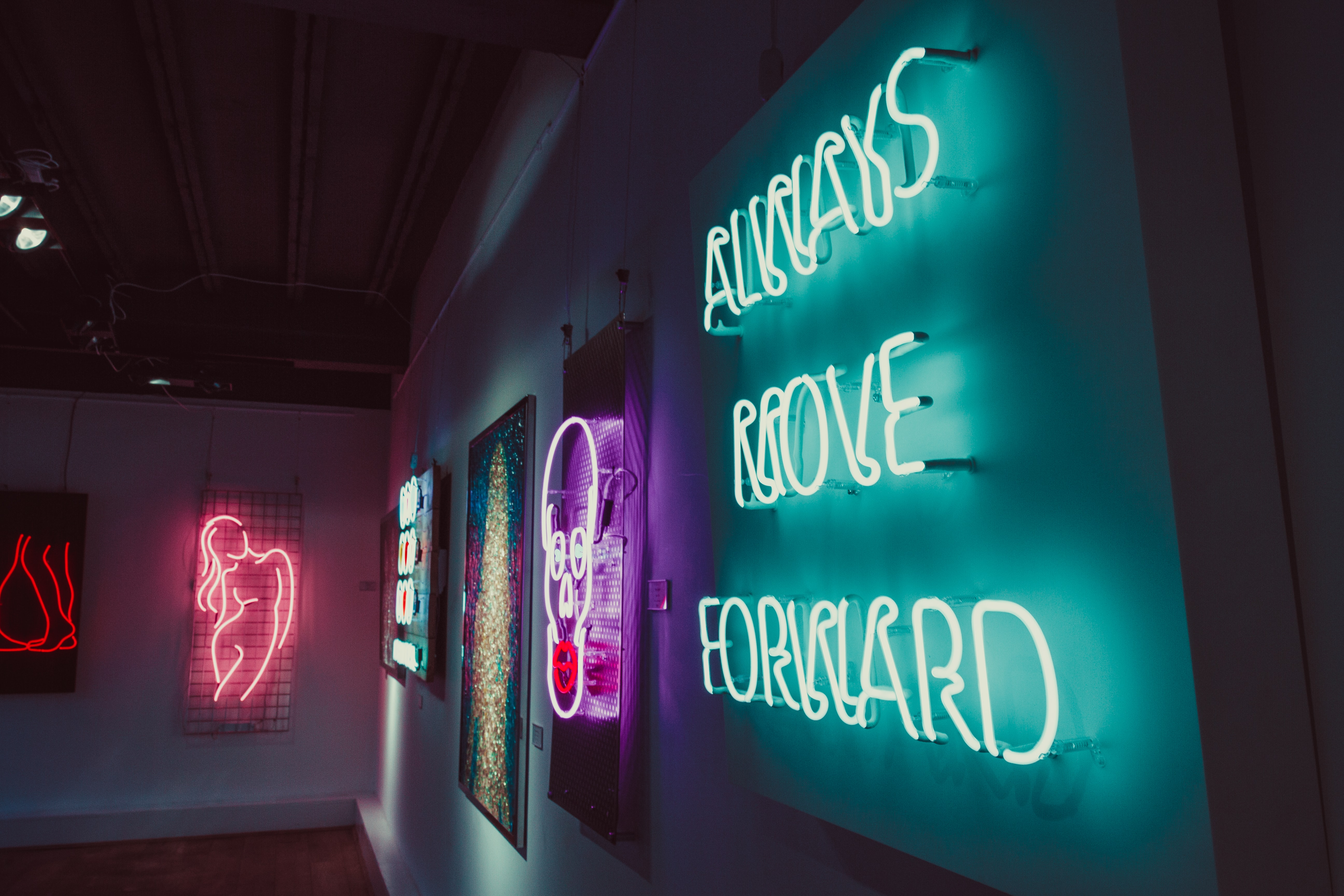 always move forward neon signage on wall