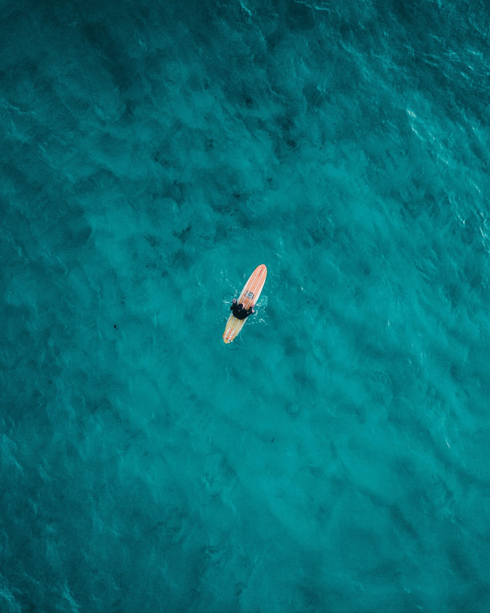 aerial photography of person on surfboard on sea