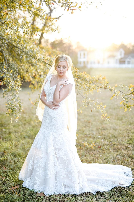 woman wearing white wedding dress near green leaf tree outdoors