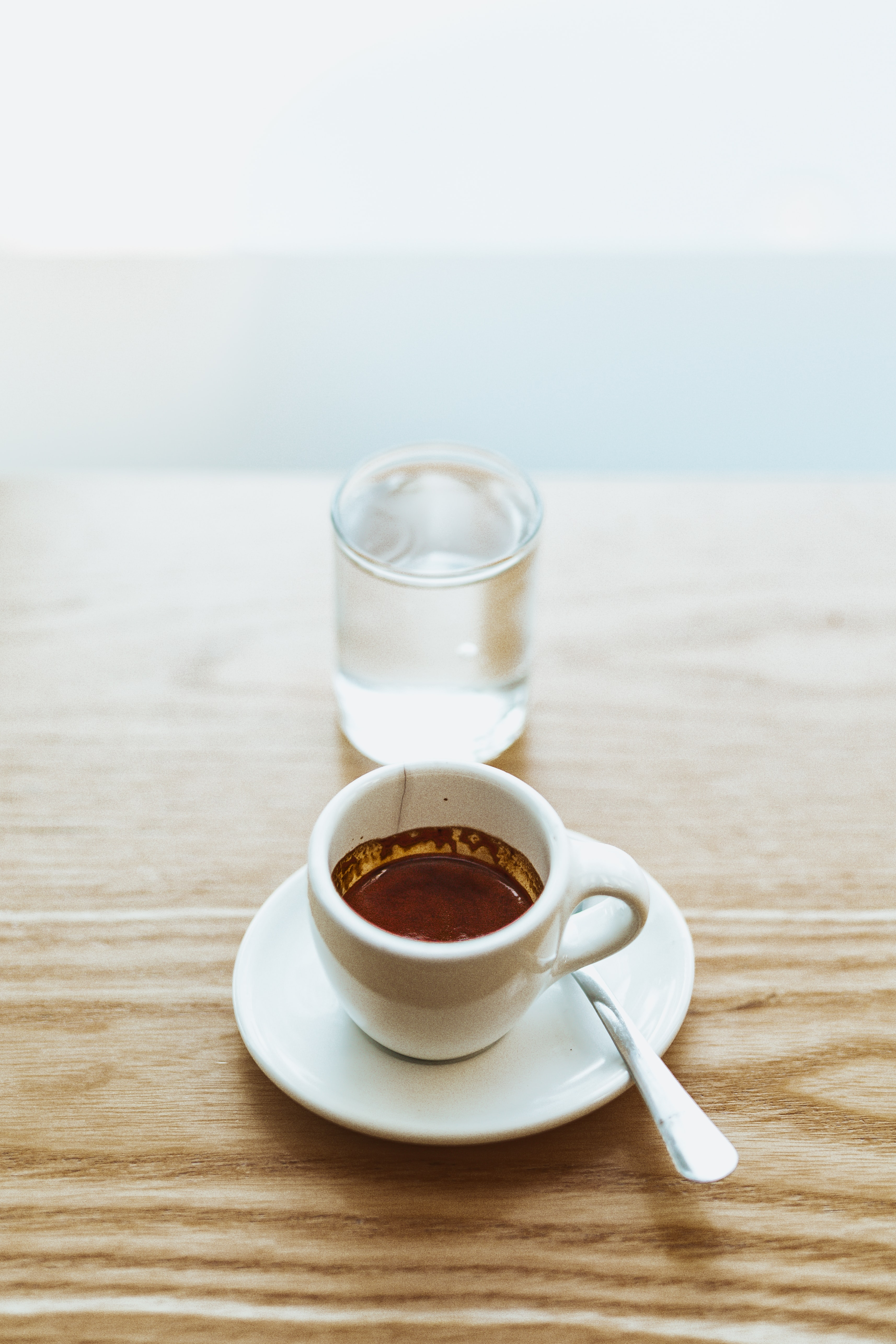 white cup with chocolate drink inside