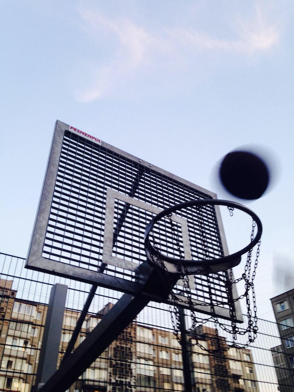 gray and black basketball hoop and backboard at daytime