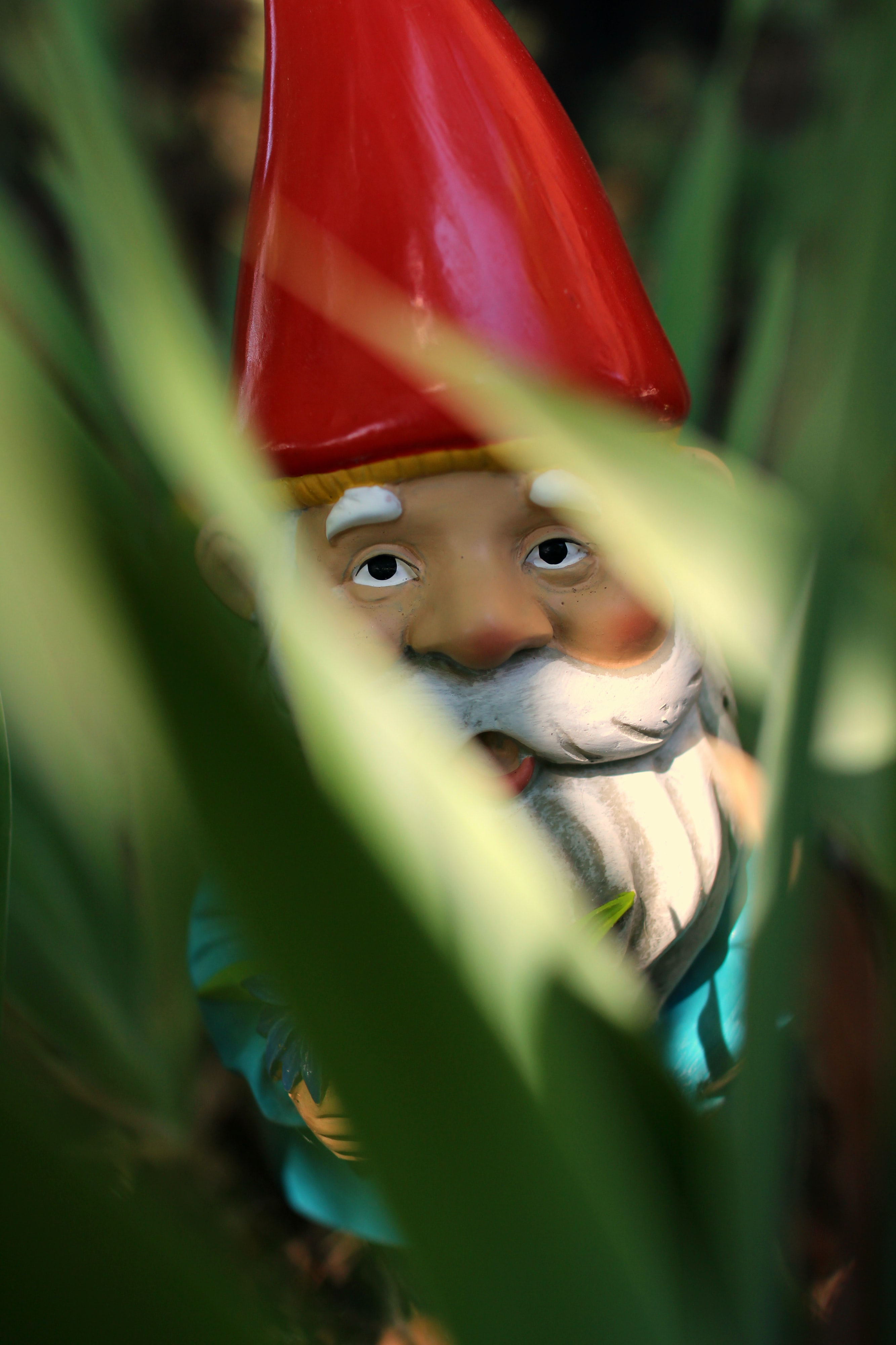 gnome standing on green grass during daytime