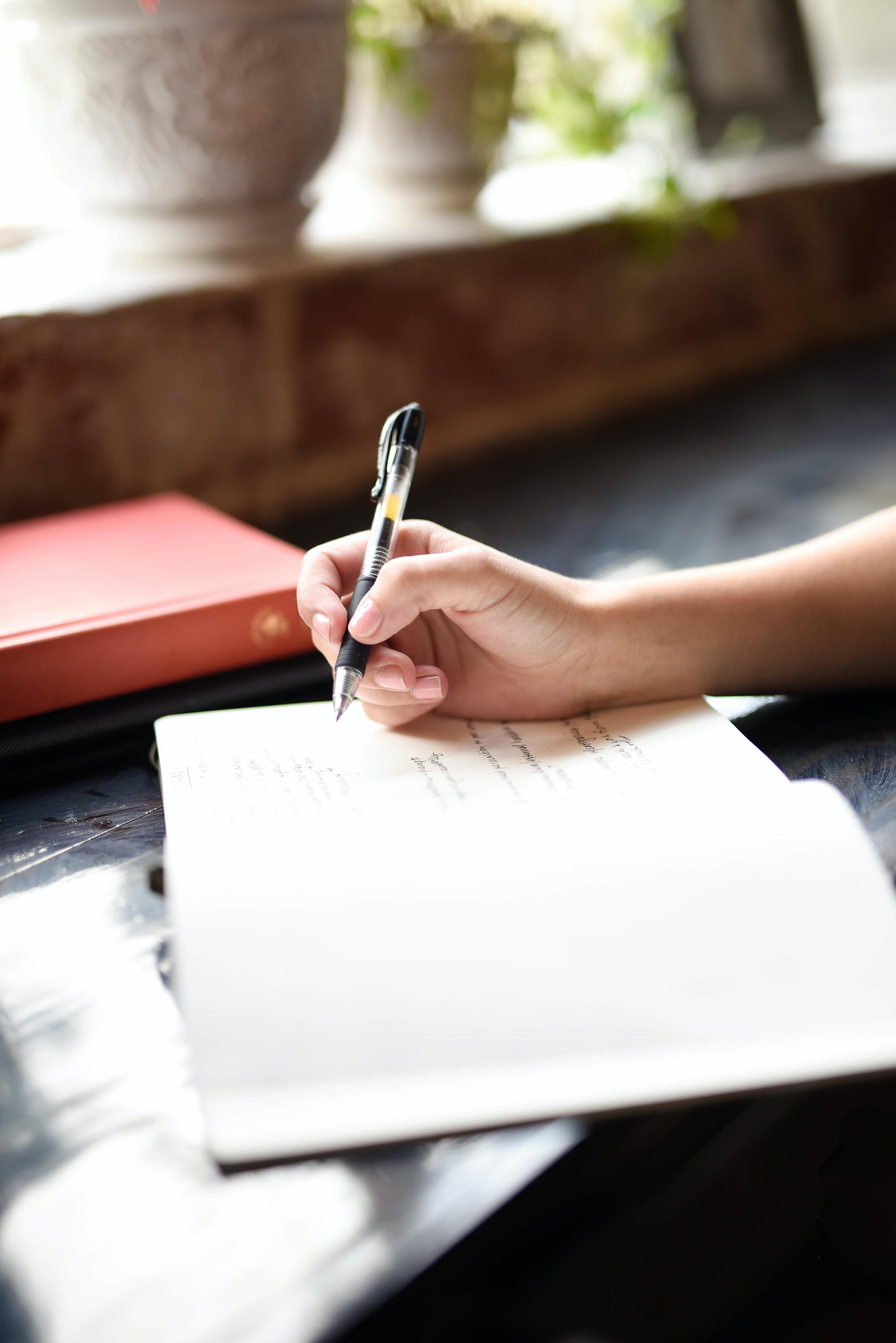 Image result for unsplash photo teacher student writing