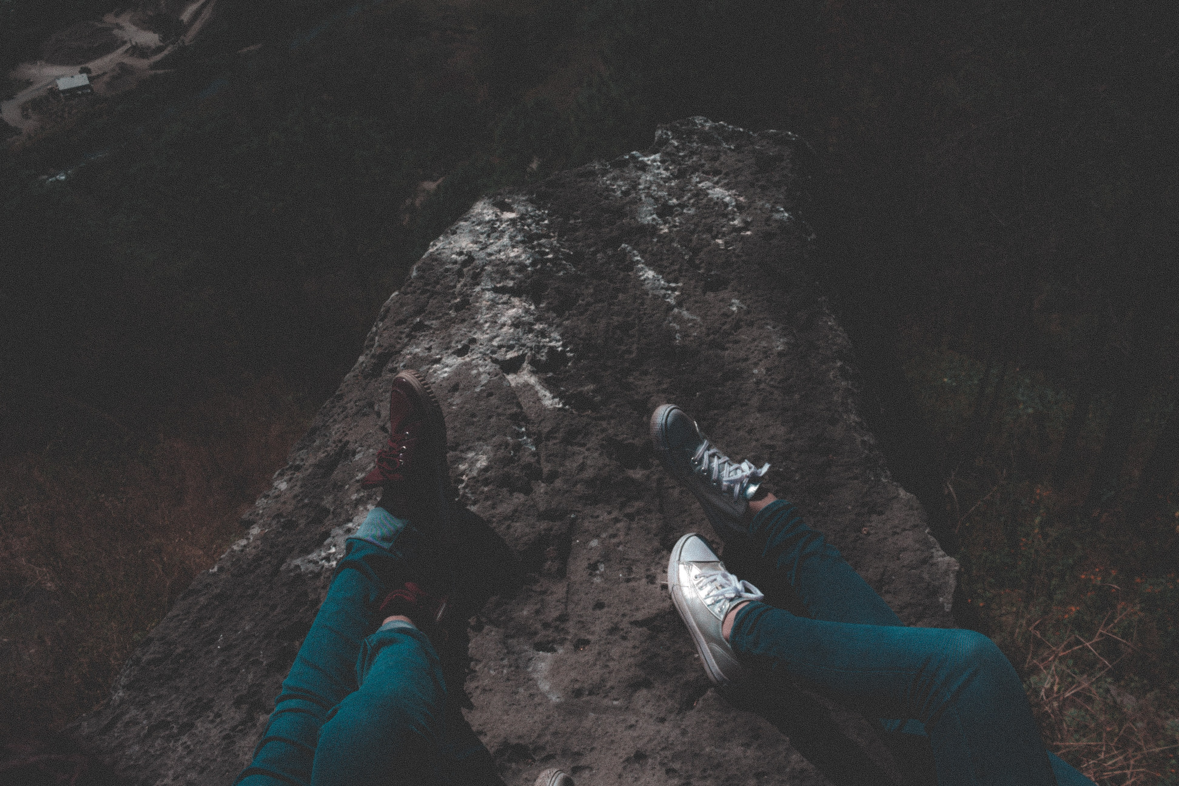 person laying on rock