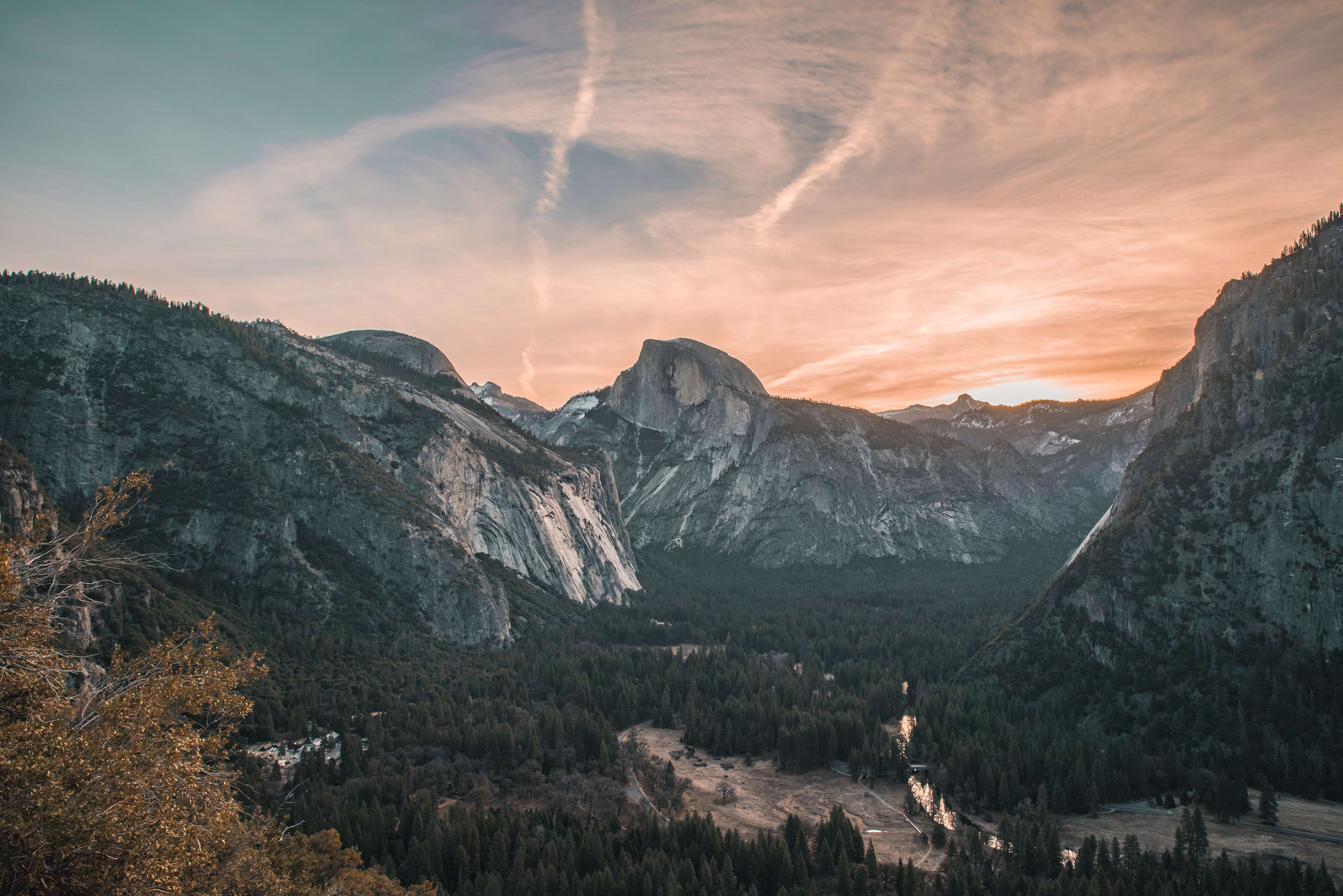 mountains surrounded by trees during golden hour