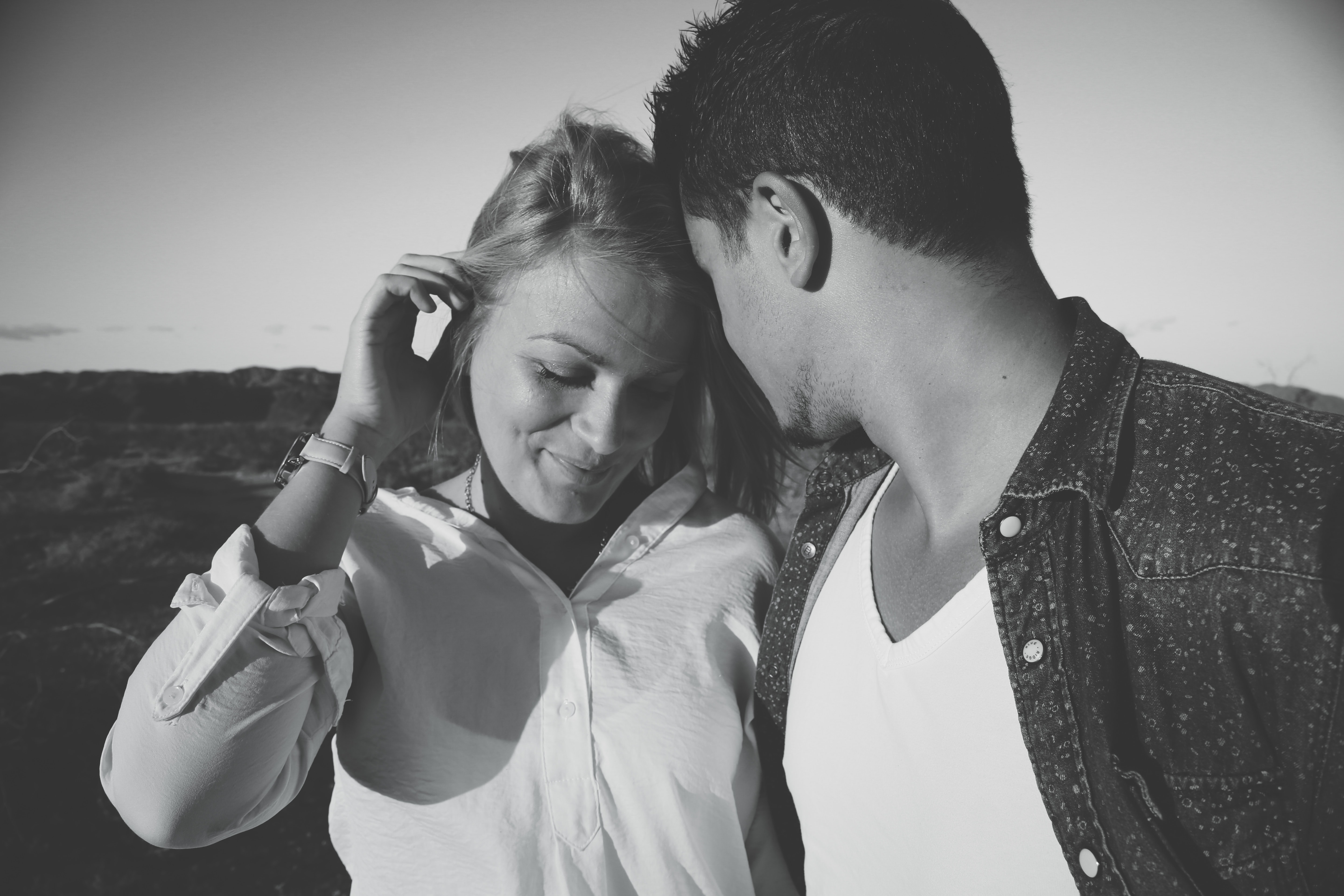 grayscale photography of man and woman