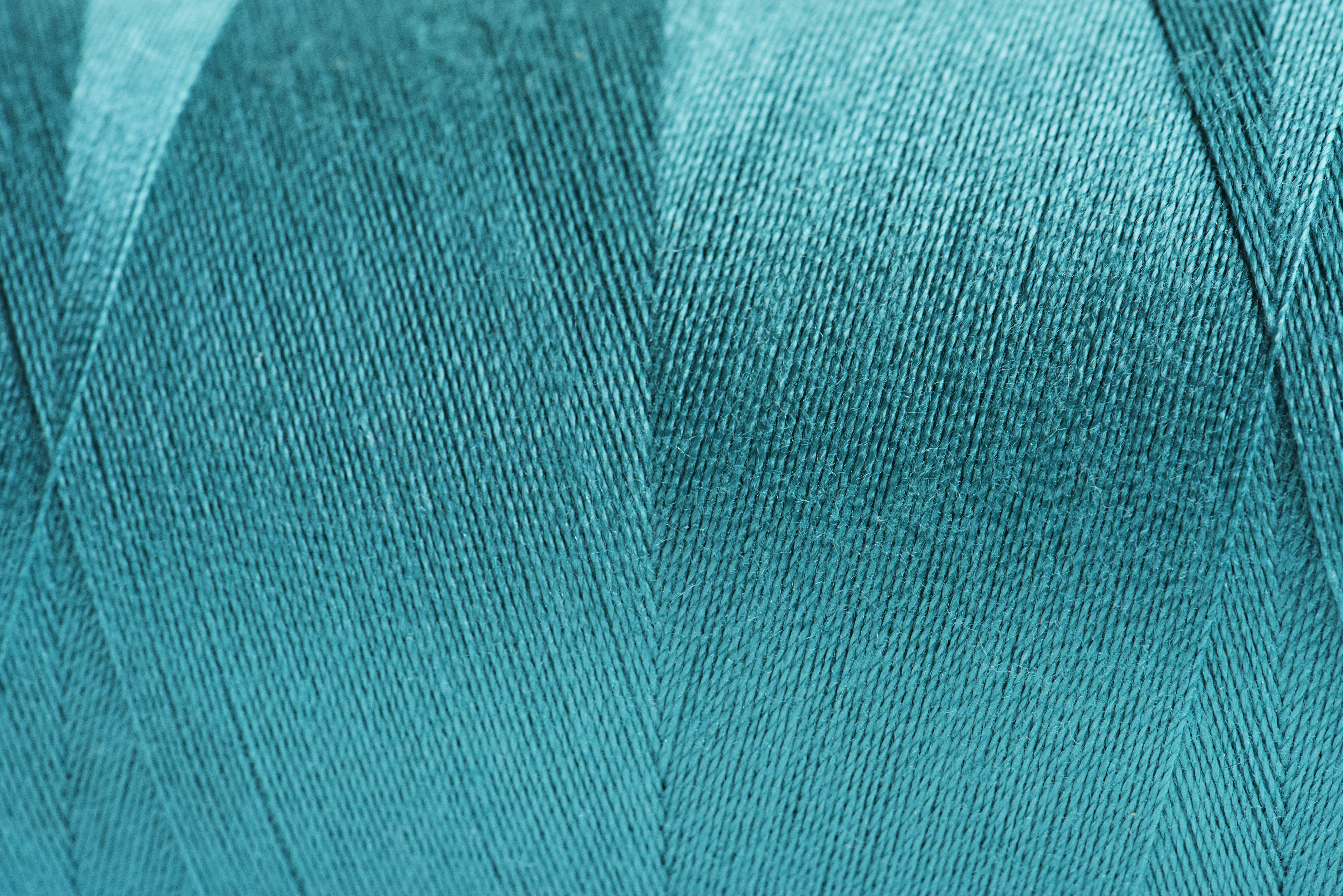 close-up photo of teal thread