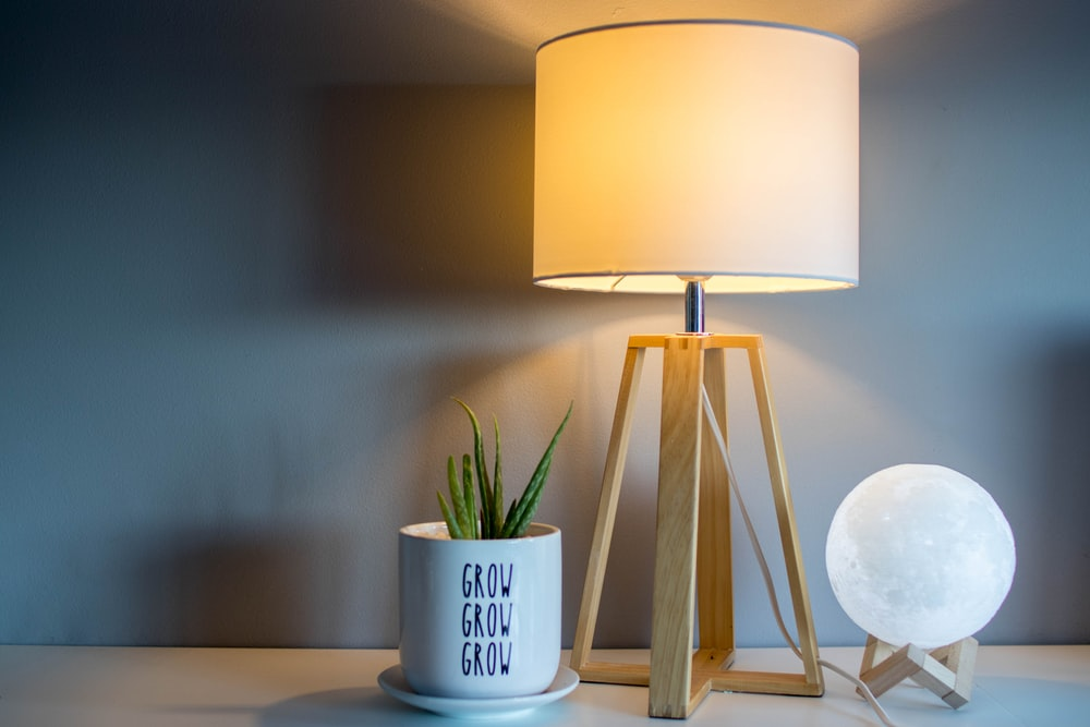 brown and white table lamp with light