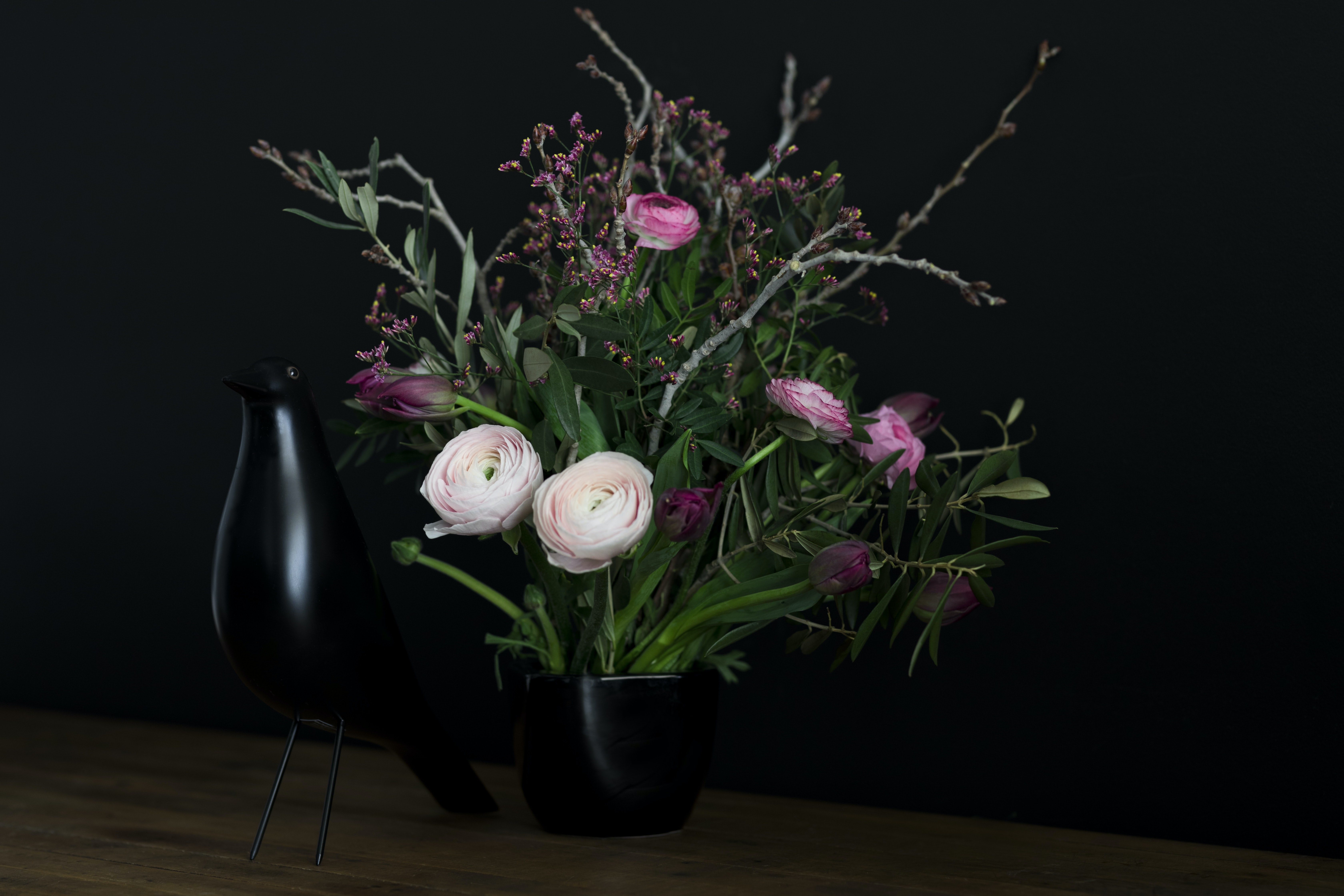 white and pink flowers with black vase