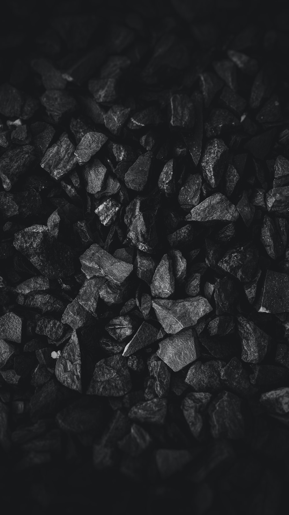 grayscale photo of stone