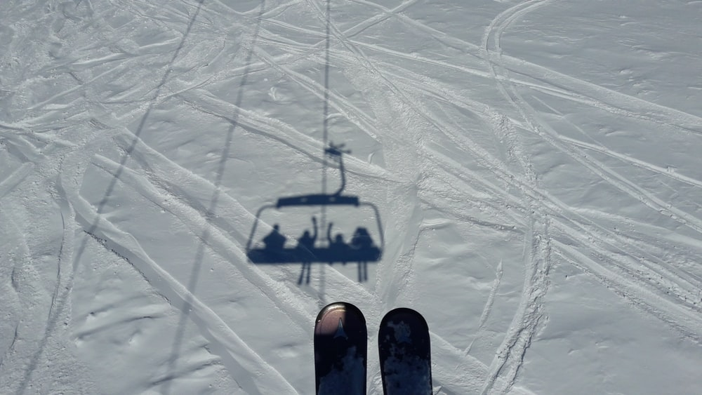 aerial photography of ski lift shadow on snow field during day