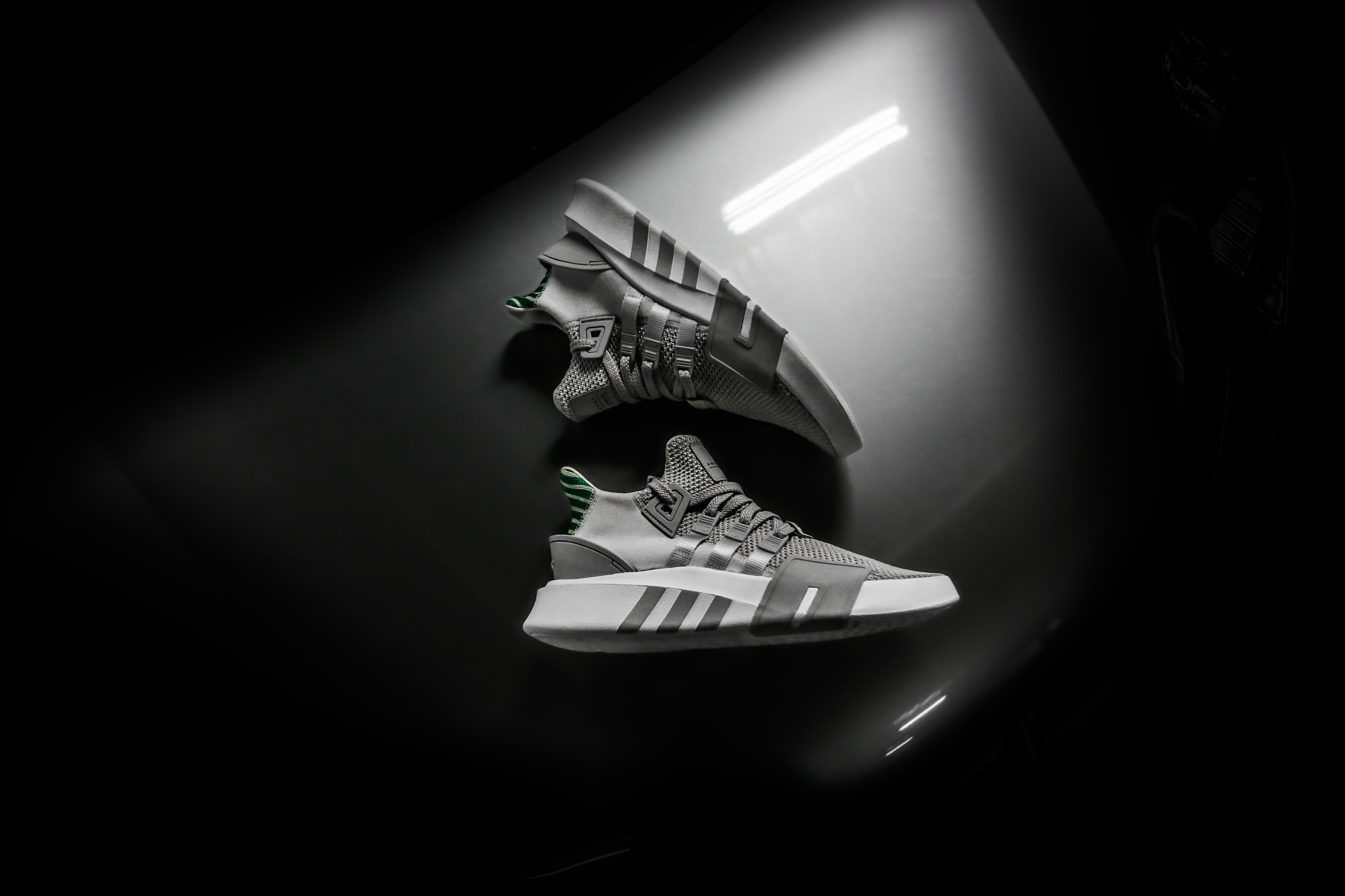 grayscale photo pair of adidas shoes