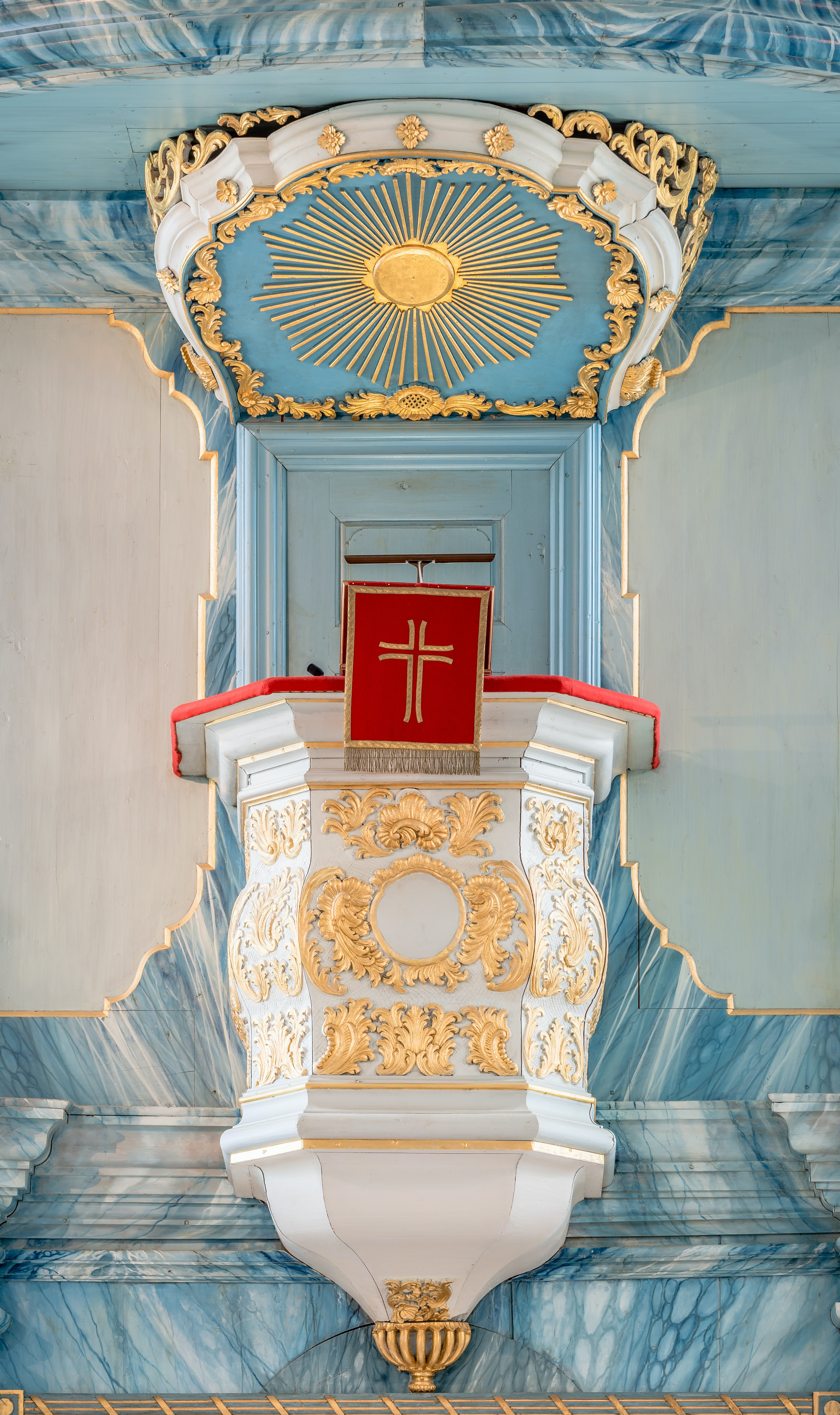 white and red altar with cross signage