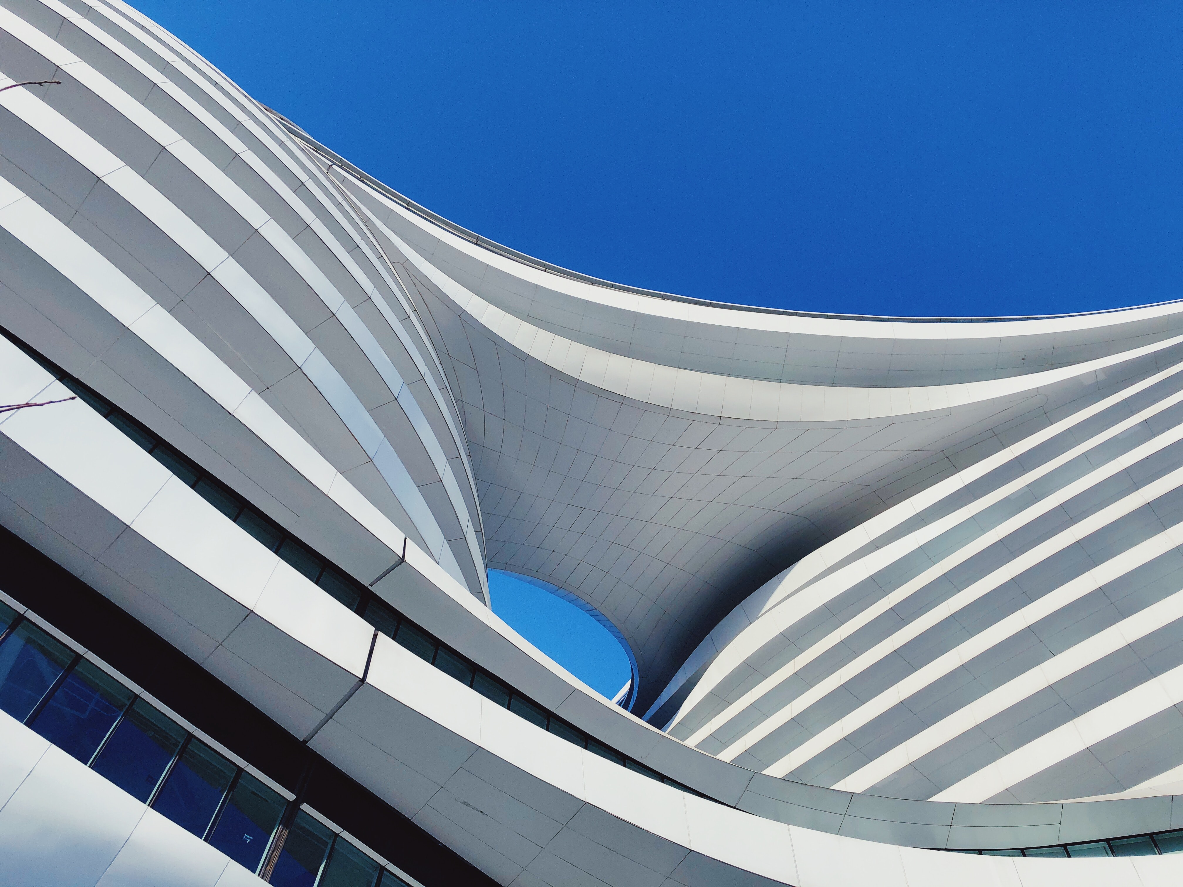 low angle photography of building under blue sky