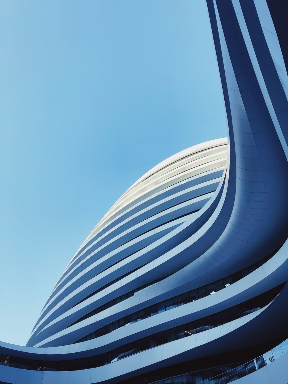 low-angle photography of state of the high-rise building under blue calm sky