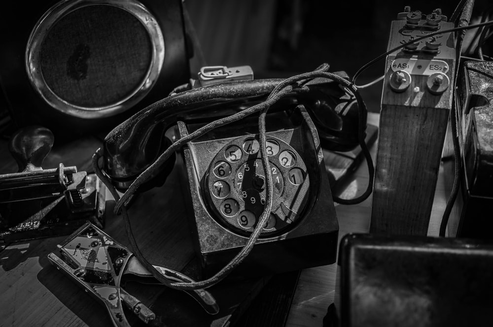photography of black dial telephone